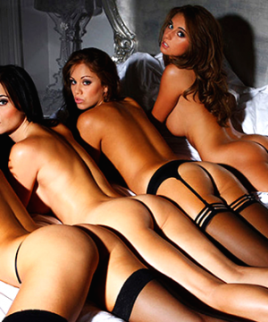 4 escorts naked on a bed