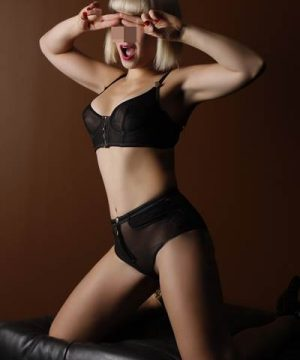 platinum blonde in black panties looking surprised