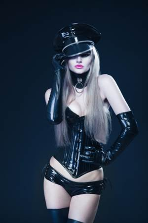 blonde in leather corset and leather cap
