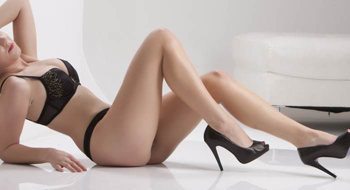 Nicky in black lingerie and six inch heels