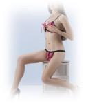 Ava posing on cabinet in skimpy lingerie