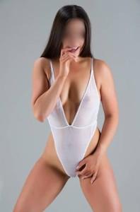 sexy brunette in white one piece