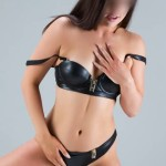 brunette female in black leather underwear