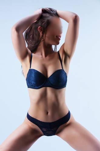 olive skinned brunette italian escort in sydney in blue lingerie