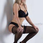 Carley black suspenders and stockings on blonde female in sydney